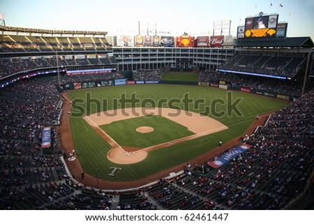 ARLINGTON, TEXAS - SEPTEMBER 27: Night game at The Ballpark in Arlington between the Rangers and Seattle Mariners on September 27, 2010 in Arlington, Texas. - stock photo