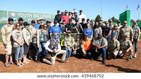 ARLINGTON, TX - APR 18: Participants at the ACM & Cabela's Great Outdoor Archery Event during the 50th Academy Of Country Music Awards at the Texas Rangers Youth Ballpark on April 18, 2015. - stock photo