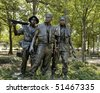 ARLINGTON,  VA - JUNE 24 ;  Vietnam war memorial statues  named 'The Three Soldiers' sculpted by Frederick Hart located in the National Mall and Memorial Parks, 24th June 2007 in Virginia, USA - stock photo