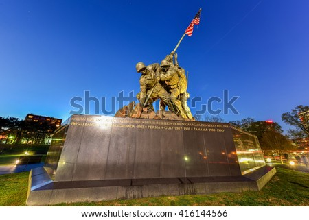 Arlington, Virginia - April 4, 2016: The United States Marine Corps War Memorial depicting the flag raising at Iwo Jima at dusk. - stock photo