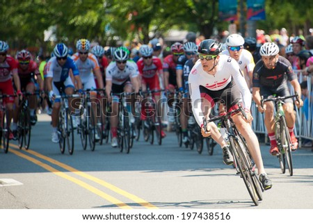 ARLINGTON, VIRGINIA - JUNE 8: A cyclist breaks away at the start of the elite men's Crystal Cup race at the Air Force Cycling Classic on June 8, 2014 in Arlington, Virginia