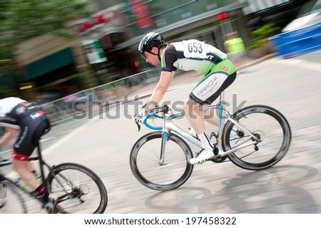 ARLINGTON, VIRGINIA - JUNE 8: A cyclist competes in the Air Force Cycling Classic on June 8, 2014 in Arlington, Virginia - stock photo