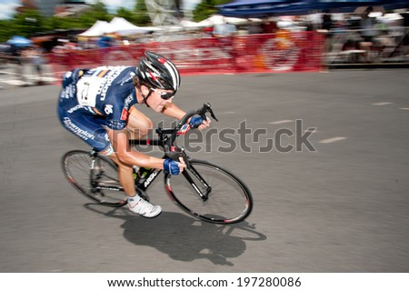 ARLINGTON, VIRGINIA - JUNE 7: A cyclist competes in the men's elite race at the U.S. Air Force Cycling Classic on June 7, 2014 in Arlington, Virginia - stock photo
