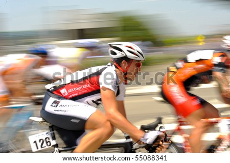 ARLINGTON, VIRGINIA - JUNE 12: A cyclist competes in the U.S. Air Force Cycling Classic on June 12, 2010 in Arlington, Virginia - stock photo