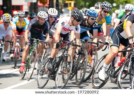 ARLINGTON, VIRGINIA - JUNE 7: Cyclists compete in the men's elite race at the U.S. Air Force Cycling Classic on June 7, 2014 in Arlington, Virginia - stock photo