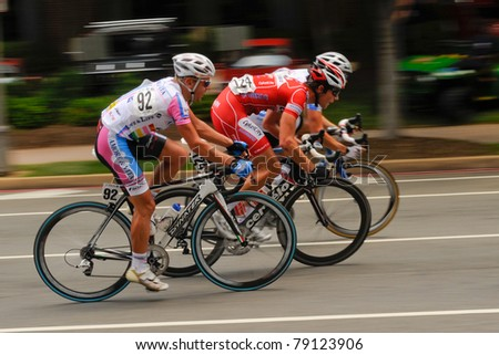 ARLINGTON, VIRGINIA - JUNE 12: Cyclists compete in the U.S. Air Force Cycling Classic on June 12, 2011 in Arlington, Virginia - stock photo