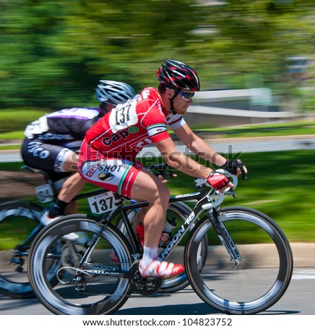 ARLINGTON, VIRGINIA - JUNE 10: Unidentified cyclists compete in the men's pro race at the U.S. Air Force Cycling Classic on June 10, 2012 in Arlington, Virginia - stock photo