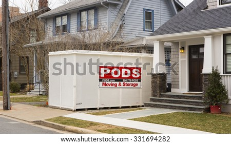 ARLINGTON, VIRGINIA, USA - MARCH 1, 2013: PODS storage container in front of houses. - stock photo