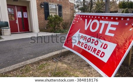 ARLINGTON, VIRGINIA, USA - MARCH 1, 2016:  Vote sign, Photo ID Required, at Lyon Village Community Center, 2016 Presidential Primary.