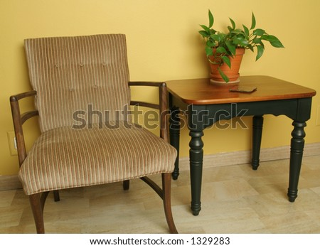 Arm chair and wood table - stock photo