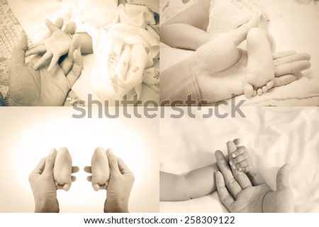 Arm Father and leg baby daughter in 7 months,vintage style - stock photo