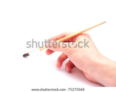 Arm with brush isolated on white - stock photo