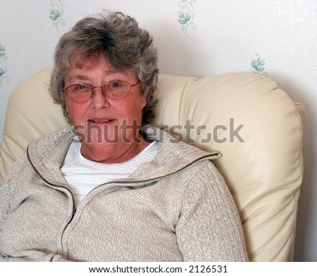Armchair driver watching the television screen relaxed - stock photo