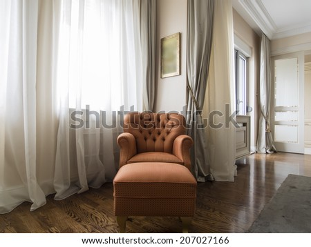 Armchair in apartment interior - stock photo