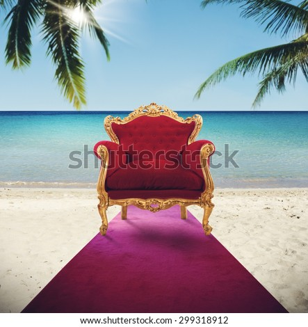 Armchair in red carpet on tropical beach - stock photo