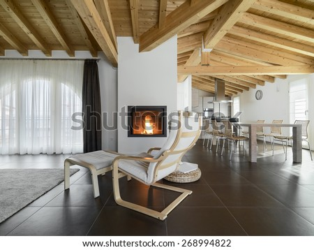 Armchair Near To Fireplace In The Living Room Of A Apartment Overlooking On Dining