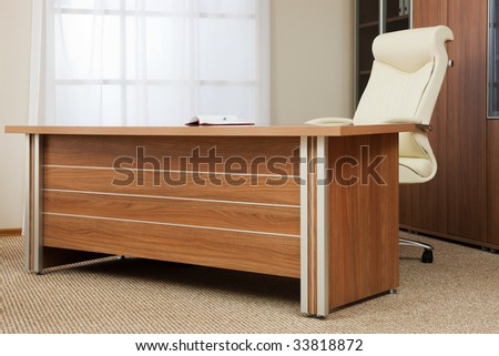 Armchair of director on a background of a window - stock photo