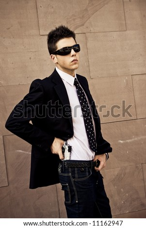 Armed agent over urban background - stock photo