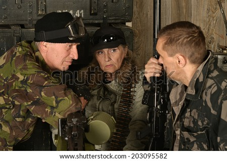 Armed combat soldiers thinking in ammunition close-up - stock photo