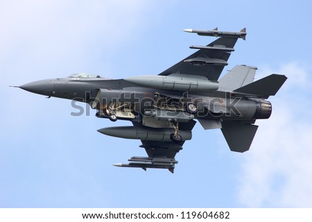 Armed fighter jet from below - stock photo