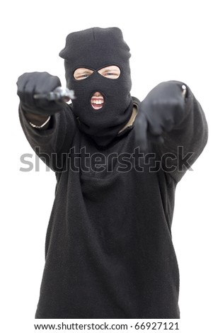 Armed Gunman Points Down While Directing His Pistol At The Camera - stock photo