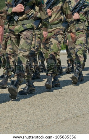 armed marching soldiers - stock photo
