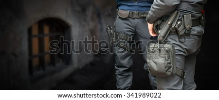 Armed policemen on guard in street at night - stock photo