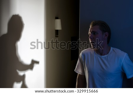 Armed Robbery Concept - Scared Homeowner Catches Thief - stock photo