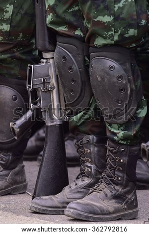 Armed Soldiers in Camouflage Military Uniform with Weapon.  - stock photo