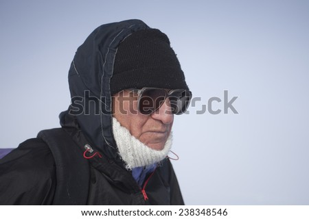 ARMENIA: 17 DECEMBER, 2014 - An old undefined man climbing in the mountains of Armenia