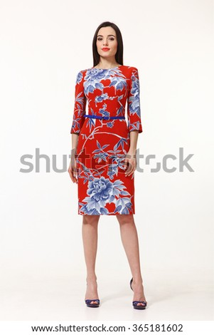 armenian asian eastern brunette business executive woman with straight hair style in party cocktail red blue printed floral belt dress  heels shoes full length body portrait standing isolated on white - stock photo