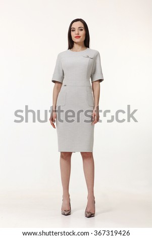 armenian asian eastern brunette business executive woman with straight hair style in white short sleeve dress high heels shoes full length body portrait standing isolated on white - stock photo