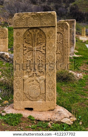 armenian Cross carved on orange stone