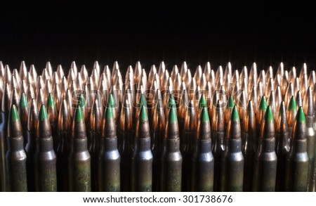 Armor piercing rifle ammunition with a black background.  - stock photo