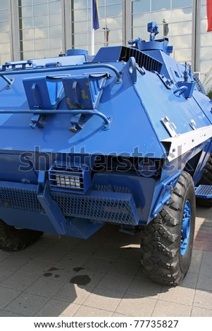 Armored police vehicle. Blue armored police vehicle.