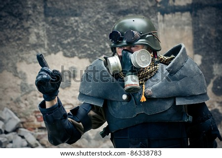 armored postnuclear fighter warning - stock photo