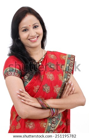 Arms crossed traditional Indian woman against white background - stock photo