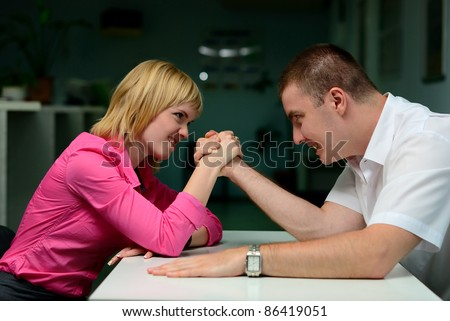 armwrestling in the office. girl vs guy