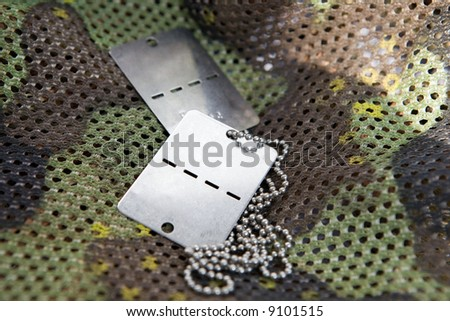 army accessories & camouflage net - stock photo
