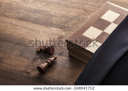 Army. Chess board with figures in the brown bag on wooden table - stock photo