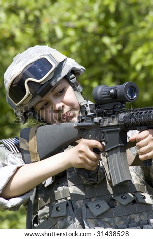 Army girl soldier aiming her rifle - stock photo