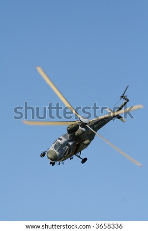 Army helicopter on blue sky