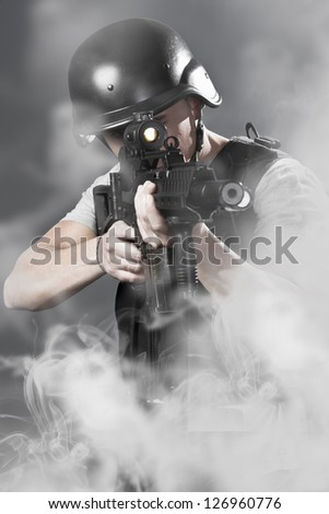 Army man over smoke background holding a machine gun - stock photo