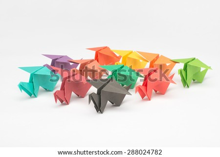 Army of Multicolored Origami Birds - stock photo