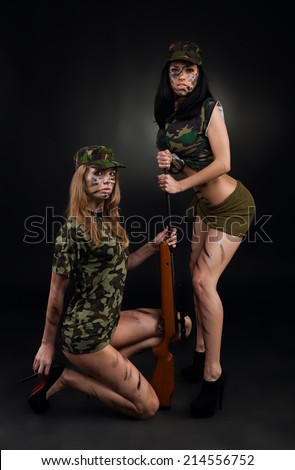 army sexy girls, two long legs soldier woman with sniper rifle wear military camouflage uniform cap full length over black background - stock photo