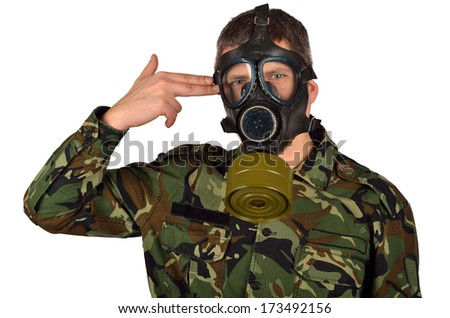 Army Soldier with A Gas Mask Kill Myself Gesture - stock photo