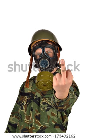 Army Soldier with Green Helmet And Gas Mask Giving the middle finger - stock photo