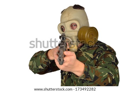 Army Soldier with Old school Gas Mask Holding a Sniper Rifle - stock photo