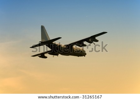 Army transport airplane departing at dawn