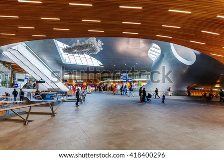 Arnhem, Netherlands - April 19, 2016: Arnhem Centraal railw station with unidentified people. After reconstruction it was reopened 2015. The new design was by UNStudio, that won an architecture price - stock photo
